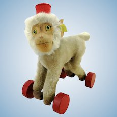 Steiff baboon Coco on eccentric wooden wheels, with button + label, first edition, produced 1951 to 1958