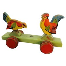 Mechanical wooden pull toy Picking Birds with ID 1950s German vintage