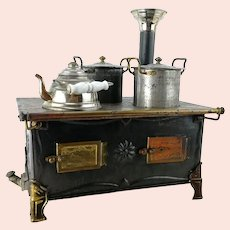 Marklin doll stove 1900 to 1910 with original dishes, 10 by 7""