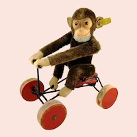 Steiff Record Peter with IDs mohair monkey sitting on carriage vintage 1949 to 1957