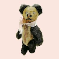 "1920s Schuco miniature teddy panda bear, 3 ½"" jointed mohair covered metal corpus"