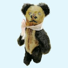 "1920s Schuco miniature teddy panda bear, 3 ½"" jointed mohair covered metal corpus"