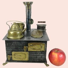 Antique doll stove 1900s by Leo Prager with dishes 7 by 6 inches