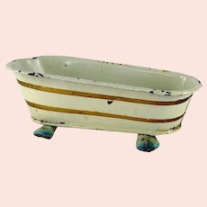 Märklin bathtub white gold 4 and a half inches long standing on feet 1910s Germany