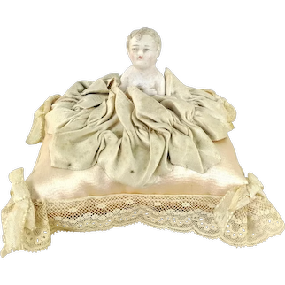Pincushion with bisque doll satin lace textile art in good condition
