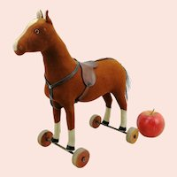 "Steiff felt horse on wooden wheels, 11"" tall, 1921 to 1928"