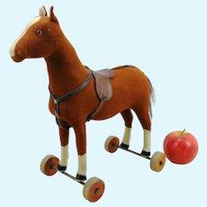 "Steiff felt horse on wooden wheels, 11"" tall, 1921 to 1928"