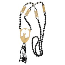 Antique Necklace of Jet Beads with Silhouette Flute Player