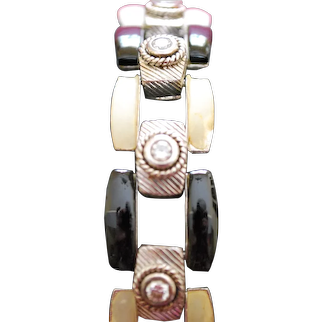 Judith Ripka Cubic Zirconia link bracelet with black and white colored rectanguler stones.