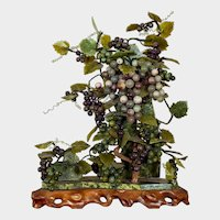 Chinese hardstone carved grape cluster on wood stand
