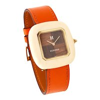 Hermes 1970 Paris 18 kt yellow gold wristwatch with rose wood and Ivory