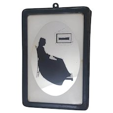 Vintage early century silhouette art on mirror