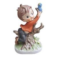 Napcoware porcelain boy and bluebird figurine