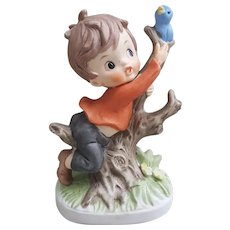 Napcoware porcelain boy and bluebird figurine