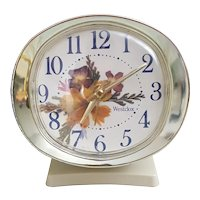 Vintage Baby Ben Westclox analog alarm clock with floral design