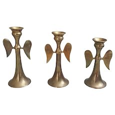 Set of three Brass Angel Wing candlesticks graduated heights