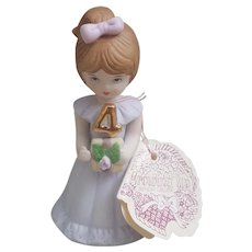 Enesco Growing Up Birthday Girls 4th Birthday figurine