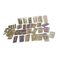 Double set of interlocking brass stencils