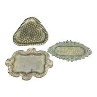 Set of three old brassy tin like hat pin trays