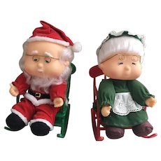 Vintage Santa and Mrs. Claus music box rockers that play Jingle Bells