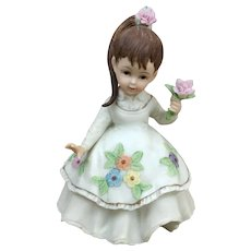 Lefton Antique Ivory Pony Tail girl figurine