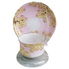 Demitasse Butterfly handle cup and saucer pink and gold