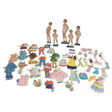 Vintage lot of random paper dolls wood standing and newspaper dolls