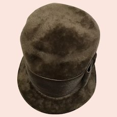 Round brown velvety faux fur hat with ribbon and bow