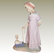 Lladro Girl with Toy Wagon 5044