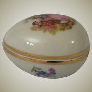 Limoges France Porcelain Egg Shaped Trinket Box with Romantic Couple and Flowers