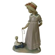 Lladro Girl with Toy Wagon aka Pulling Dolls Carriage Porcelain Figurine Model 5044