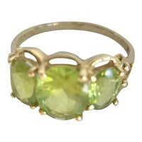14K Yellow Gold Ring with Three Oval Green Peridot Stones