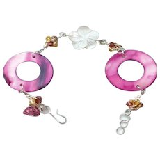 Pink Lipshell Donuts, White Flower Lipshell and wire wrapped amber Swarovski Bracelet