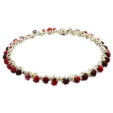 Wire wrapped bangles with red Swarovski crystals