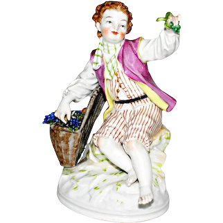 Antique Berlin KPM Porcelain Figurine of a seated Boy with Fruit and Grape Basket Ca Late 19th C