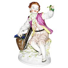 Antique KPM Porcelain Figurine of a Seated Boy with Fruit and Grape Basket