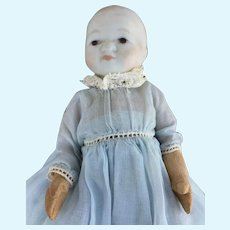 """4"""" Carved Wood Baby Doll with Bisque Head in Hand Made Dress"""
