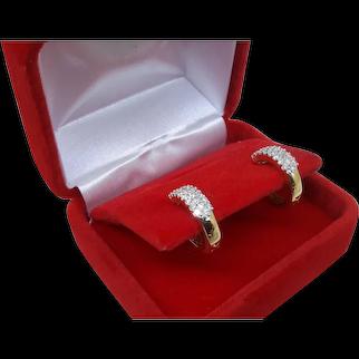 14 Karat yellow  gold diamond earrings.