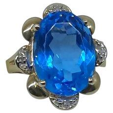 10 karat Blue Topaz and Diamond  Oval Ring