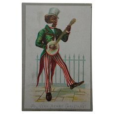Victorian Christmas Card featuring a Minstrel.
