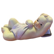 Lefton China Reclining Piano Baby
