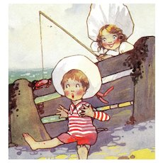 British, unposted, artist signed Richardson postcard of children at beach