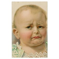 Unposted postcard of crying infant