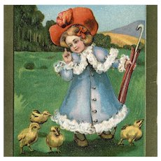 Antique gilded, embossed Easter postcard of child and chicks posted 1908
