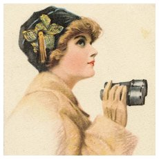 Artist signed Desch postcard of glamorous woman with binoculars