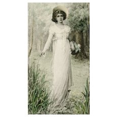Unmarked, unposted, undivided back M M Vienne postcard of beautiful woman in springtime