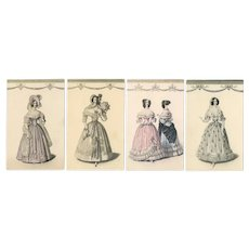 Set of 4 unposted, hand colored postcards of glamour women