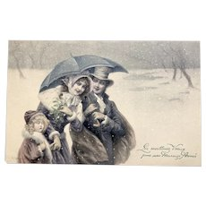 Charming Holiday Wichera Artist Signed postcard published by M M Vienne of a charming family
