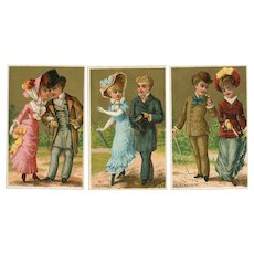 Set of three French, gilded trade cards of couples courting