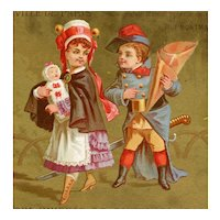 Unusually large French, gilded trade card of couple with infant